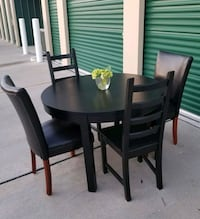 round black wooden table with four chairs dining set Frisco, 75034