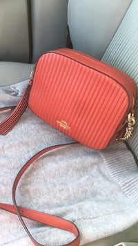 Red coach leather crossbody bag retail price 275 so no low ballers pls  Mississauga, L4W 1M3
