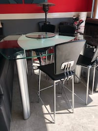 Gray & black glass dining table with glass lazy Susan ...comes with 6 chairs ...excellent condition...originally bought from La Diff Midlothian, 23113
