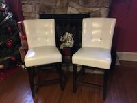 two white leather padded chairs