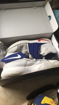 Pair of white-and-blue nike basketball shoes Halifax, B2V 1N5