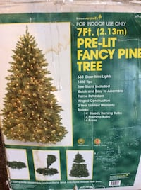 7ft Artificial Christmas tree with some lights, may need replaced or checked for loose ones Baden, 15005