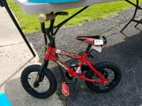 toddler's red and black bicycle with training wheels North Potomac, 20878