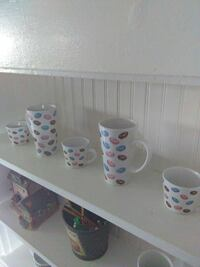 five white ceramic mugs