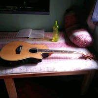 brown and black acoustic guitar in case
