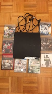black Sony PS3 slim console with game cases Hamilton, L8W