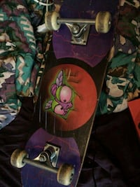 purple and green floral skateboard