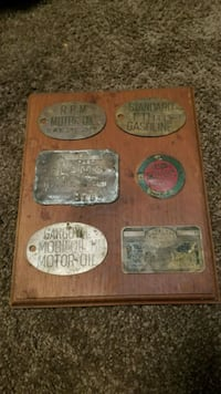 Antique Gas Pump tags on Wooden board  Chestermere, T1X 0P1