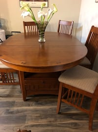 round brown wooden table with four chairs dining set San Antonio, 78253