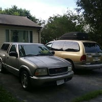 gray GMC Sonoma truck single cab with camper shell Laurel, 20707