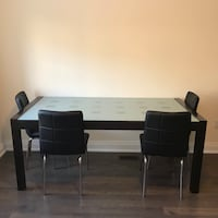 rectangular black wooden table with four chairs dining set Toronto, M4G 3X2