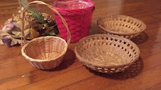 four brown and pink wicker baskets