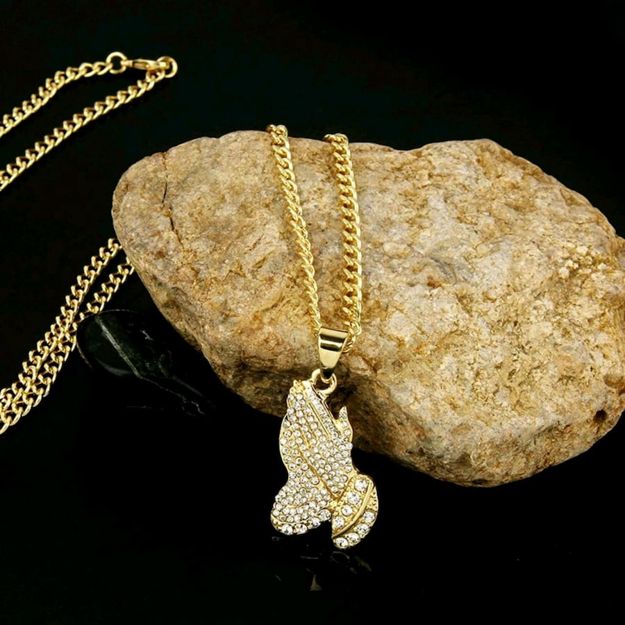 silver chain link necklace with gold pendant