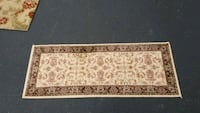 brown and white floral area rug New Market, 21774