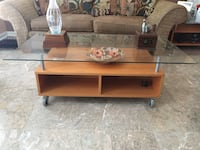 brown wooden framed glass top TV stand Laurel, 20708