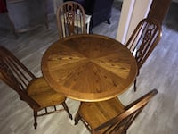 Round wooden table with four chairs Selbyville, 19975