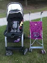 Baby's black and pink stroller Calgary, T1Y