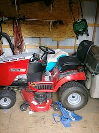 red and black ride on mower 1375 mi