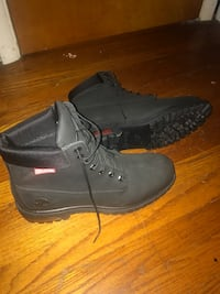 pair of black Timberland work boots 315 mi