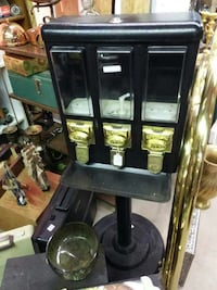 Black and gold Seaga gumball candy machine