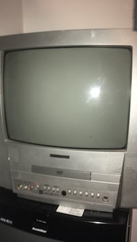 gray CRT TV with remote