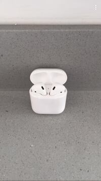 white Apple AirPods in case