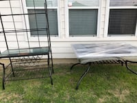 Black steel table and rack with 4 chairs ...price is negotiable also the table and rack has dark tile decor  Dallas, 75217