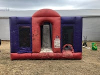 Slide obsticle course bounce house comes with blower.