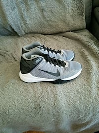 pair of gray-and-white Nike running shoes Longmont, 80501