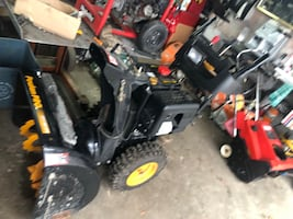 Black and red ride on mower