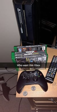 Xbox One console with controller and game cases 606 mi