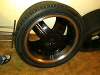 Chevy black 5-spoke car wheel with tire Altoona, 50009