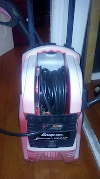 white and purple Bissell vacuum cleaner