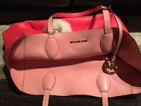 Authentic Michael kors reversible purse. Like new condition. Colours are coral and pink grapefruit  Saskatoon, S7H 3W3