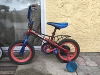 red bicycle with trainign wheels