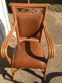 Brown wooden padded armchair