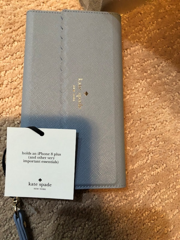 Brand new iphone plus cover from Kate Spade 0af39363-34a3-49e7-84af-c4213f348492