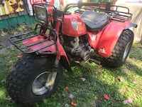 red and black Honda trike Mille-Isles, J0R