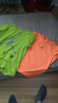 green and orange Air Jordan crew-neck shirts