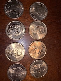 Set of gold One Dollar coins