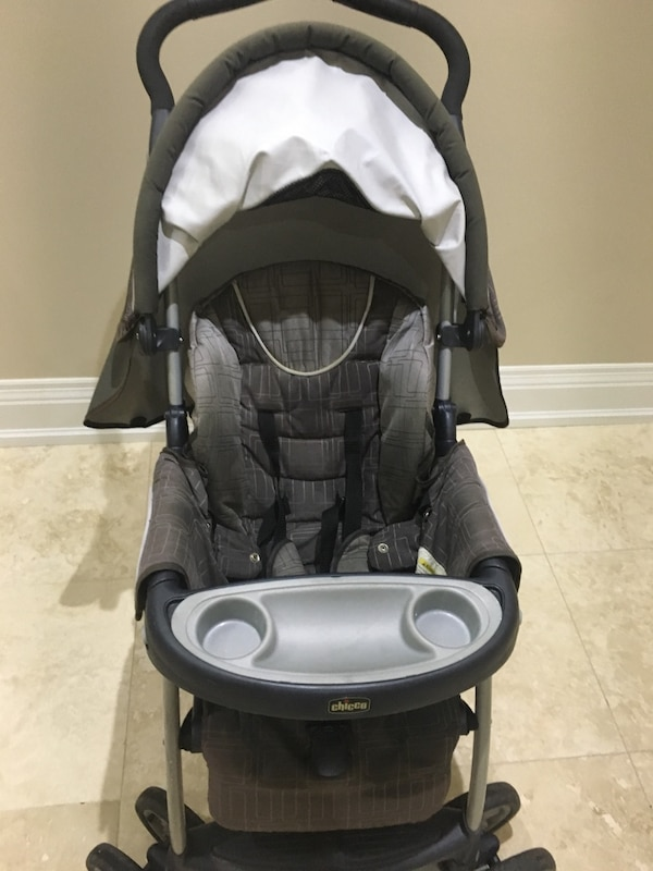 Baby's black and gray chicco stroller