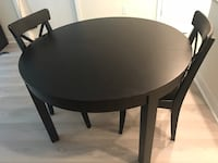 Black round table (extendable) and 2 chairs