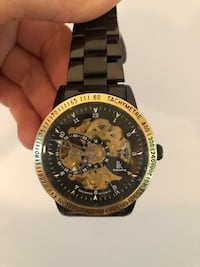 Round gold-colored chronograph watch with link bracelet Toronto, M4W 2G4