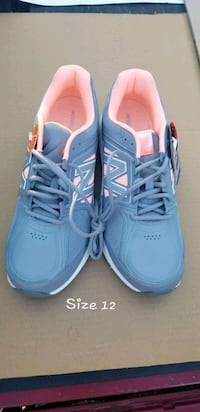 pair of blue Nike running shoes St. Louis, 63113
