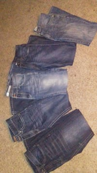 three blue and one black denim bottoms Red Deer, T4P 2H7