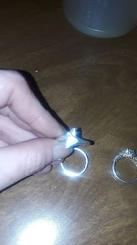 three silver-colored rings