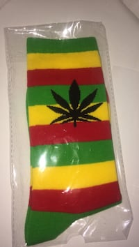green, red, and yellow cannabis print textile