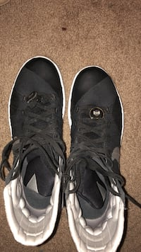 pair of black-and-gray basketball shoes