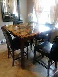 square brown marble-topped brown wooden based dine