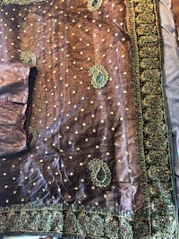 Beautiful brown saree with stitch blouse